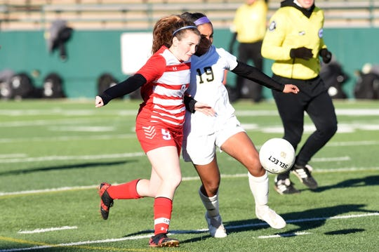 Cooper's Honna Turner (9) battles Wichita Falls Rider's Ruth Vasquez (19) for the ball at Shotwell Stadium on Tuesday, March 5, 2019.