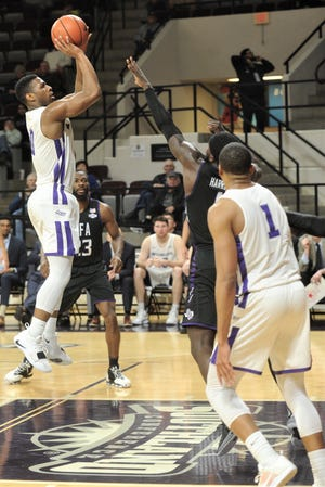 ACU's Jaylen Franklin, left, shoots over Stephen F. Austin's Kevon Harris in the second half. ACU beat the Lumberjacks 72-58 in the Southland Conference game Tuesday, March 5, 2019, at Moody Coliseum.