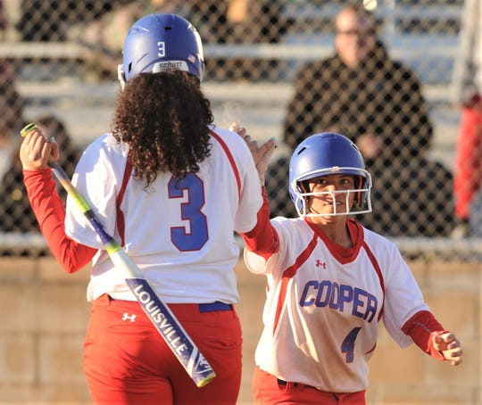 Aliyah Martinez, right, is congratulated by Kaleigha Kemp after scoring on Jada Willis' two-out, RBI single in the sixth inning. The run tied the game at 5, and the Lady Cougars scored six runs in the inning to beat Wichita Falls High 9-5 on Tuesday, March 5, 2019, at Cougar Diamond.