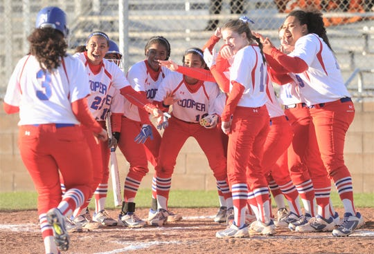Cooper players wait to congratulate Kaleigha Kemp (3) after she hit a solo homer in the fifth inning. The Lady Cougars beat Wichita Falls High 9-5 in the District 4-5A opener Tuesday, March 5, 2019, at Cougar Diamond.