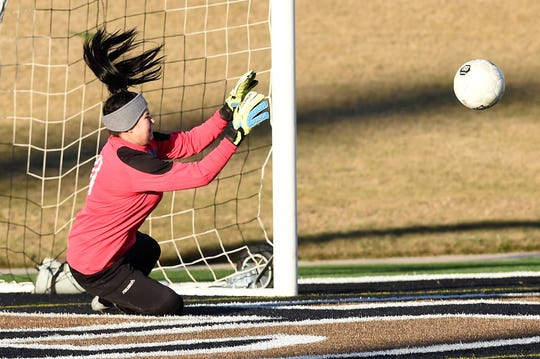 Cooper goalkeeper Brandy Hagood (0) makes a save against Wichita Falls Rider at Shotwell Stadium on Tuesday, March 5, 2019.