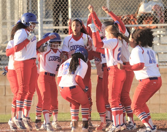 Cooper players celebrate as Symone Gary scores on a three-run home run to cap a six-run sixth inning. The big inning lifted the Lady Cougars to a 9-5 victory over Wichita Falls High in a District 4-5A game Tuesday, March 5, 2019, at Cougar Diamond.