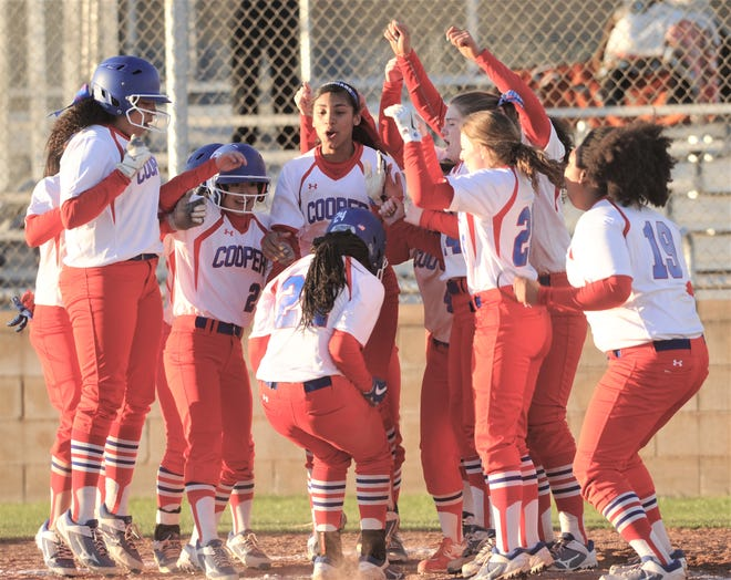 Cooper players celebrate as Symone Gary scores on a three-run home run to cap a six-run sixth inning. The big inning lifted the Lady Cougars to a 9-5 victory over Wichita Falls High in a District 4-5A game March 5 at Cougar Diamond.