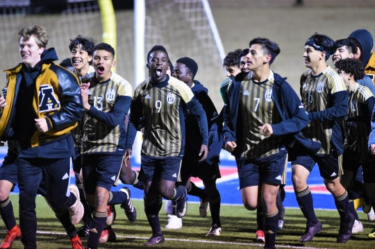 The Abilene High boys soccer team celebrates earning two points against Euless Trinity at Shotwell Stadium on Tuesday, March 5, 2019. The Eagles came back to tie the game 2-2 in regulation and won 5-4 in penalty kicks.