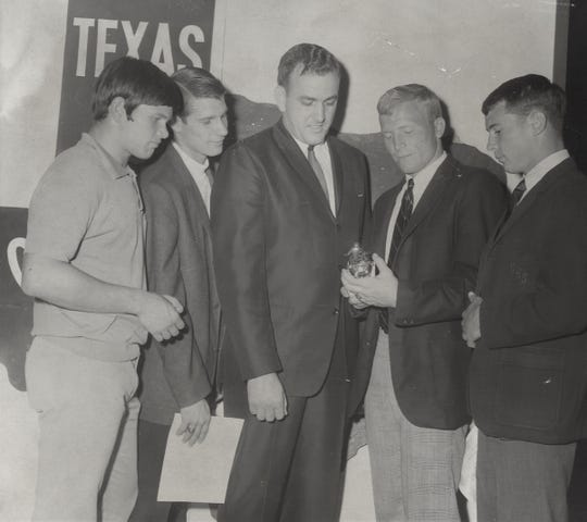 Jon Harrison, right, joined three other Cooper High School athletes as all-American athletes in 1968.  From left are basketball Tom Stanton, Jack Mildren, Ricky Rodgers and award presenter Roy Fey.