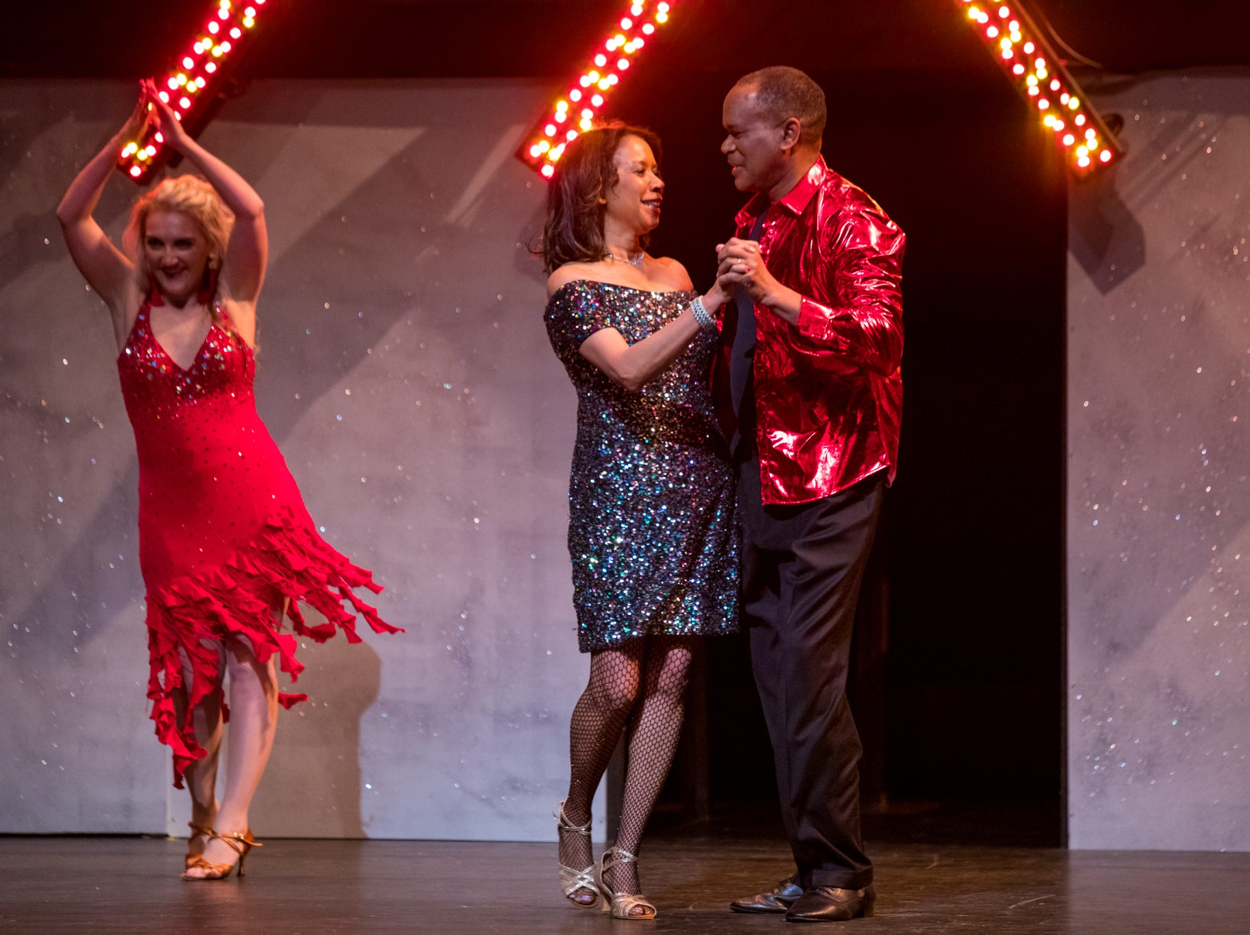 """Robby Russell and his wife Michelle perform with pro partner Elena Binder at the inaugural """"Dancing with the Local Stars"""" fundraiser for the American Cancer Society Feb. 24, 2019, at the Diana Wortham Theatre."""