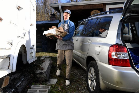"Brennan Johnson loads loaves made with milled wheat bran into his vehicle for delivery through his community-supported bakery on Feb. 26, 2019. Johnson created a month's worth of loaves under the theme ""breads of resourcefulness"" in February."