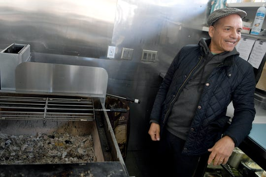 Chef Hector Diaz shows off the charcoal used to prepare the Chicken Al Carbon that he will be focusing on at his restaurant, Bomba, on March 5, 2019.