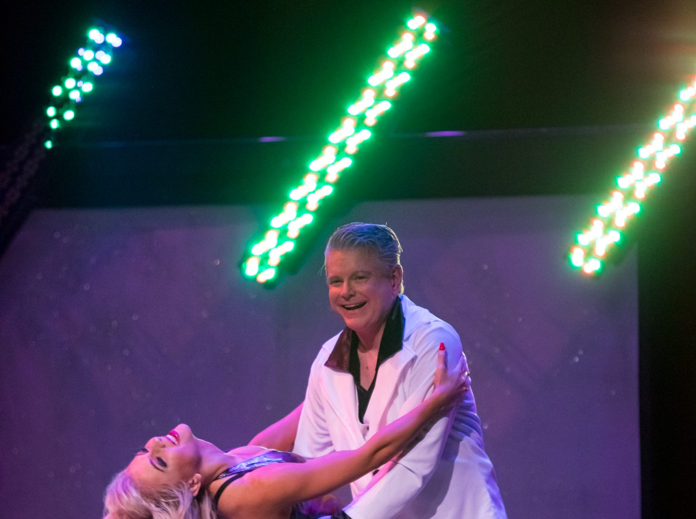 """John Pierce and pro dance partner Olivia Hughes perform at the inaugural """"Dancing with the Local Stars"""" fundraiser for the American Cancer Society Feb. 24, 2019, at the Diana Wortham Theatre."""