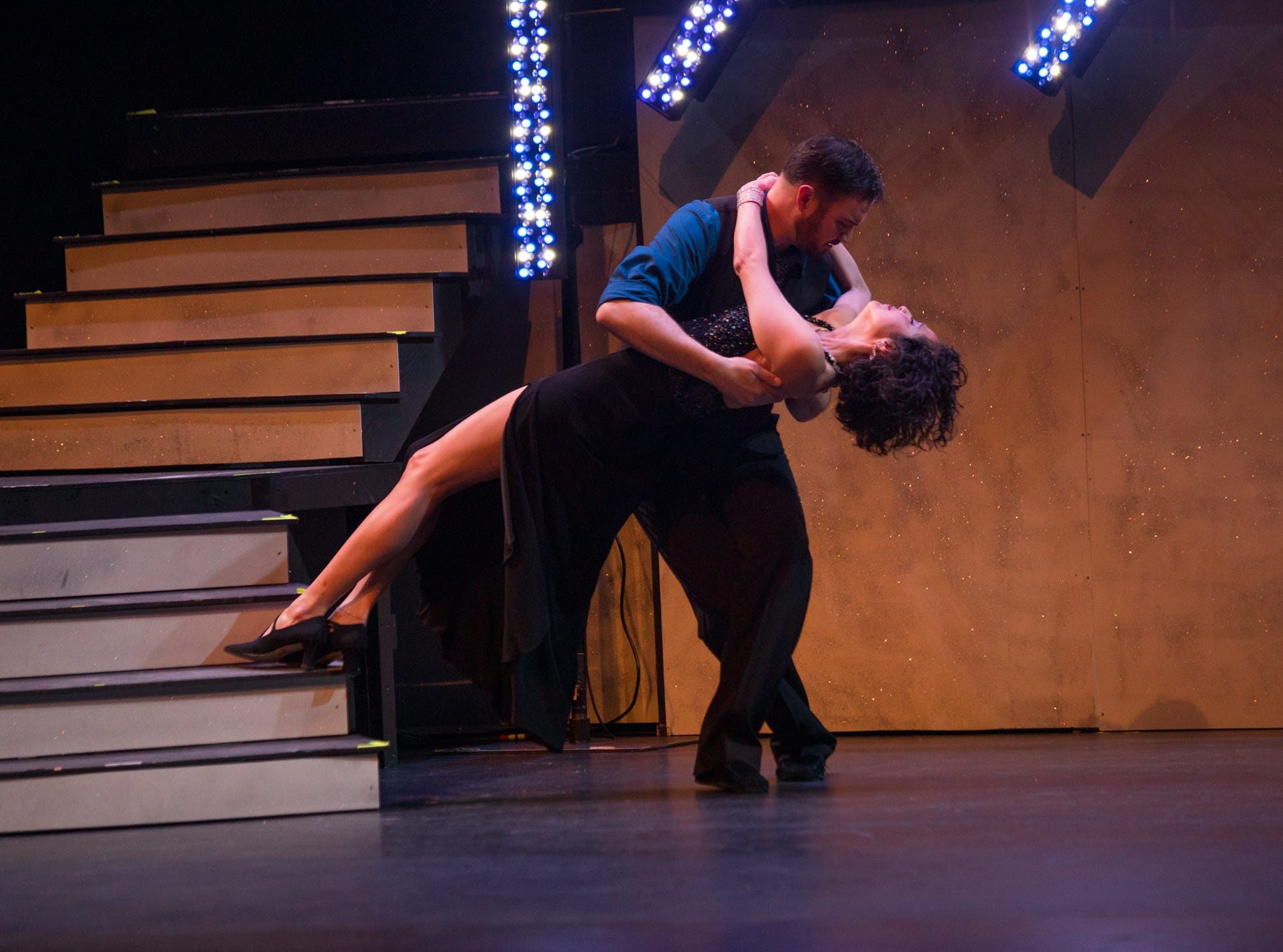 """Citizen Times outdoors reporter Karen Chavez and pro dance partner Jason Barnes perform at the inaugural """"Dancing with the Local Stars"""" fundraiser for the American Cancer Society Feb. 24, 2019, at the Diana Wortham Theatre."""
