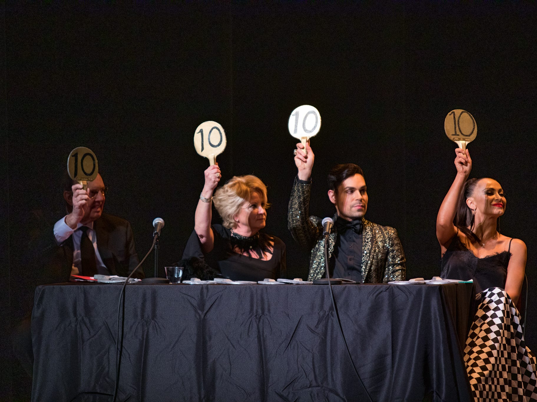"""K. Ray Bailey, Juli Dave, professional dancer Charlton Alicea and Karina Smirnoff of ABC's """"Dancing with the Stars"""" judge the """"Dancing with the Local Stars"""" fundraiser for the American Cancer Society Feb. 24, 2019, at the Diana Wortham Theatre."""