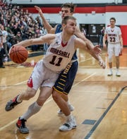 Marshall's Jack Luciani (11) and Haslett's Sam Laczynski (23) during first half action of regional playoffs Tuesday evening.