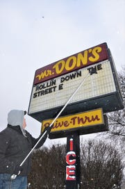 Scott Murphy, owner of Mr. Don's Restaurant in Springfield, puts up letters on the marquee in front of his business on Monday, March  4, 2019.