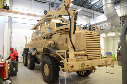 A massive mine clearing vehicle called a Buffalo is parked at Fort Custer Training Center as part of a new training program at the base.