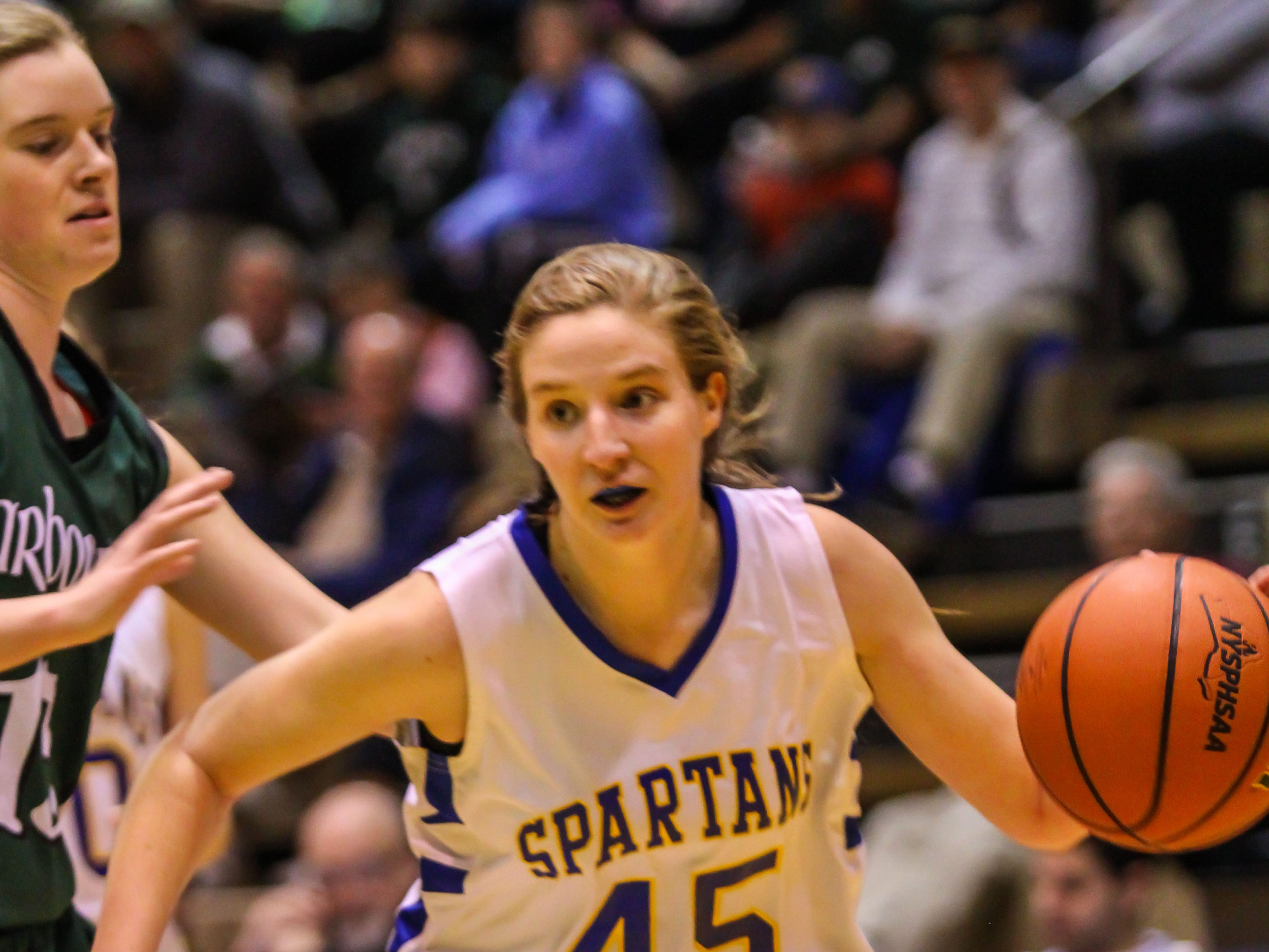 2013: Becca Dewing drives to the basket during Maine-Endwell's 53-46 victory over Harborfields in the Class A state semifinals Friday at Hudson Valley Community College. Dewing equaled a team-high with 12 points.