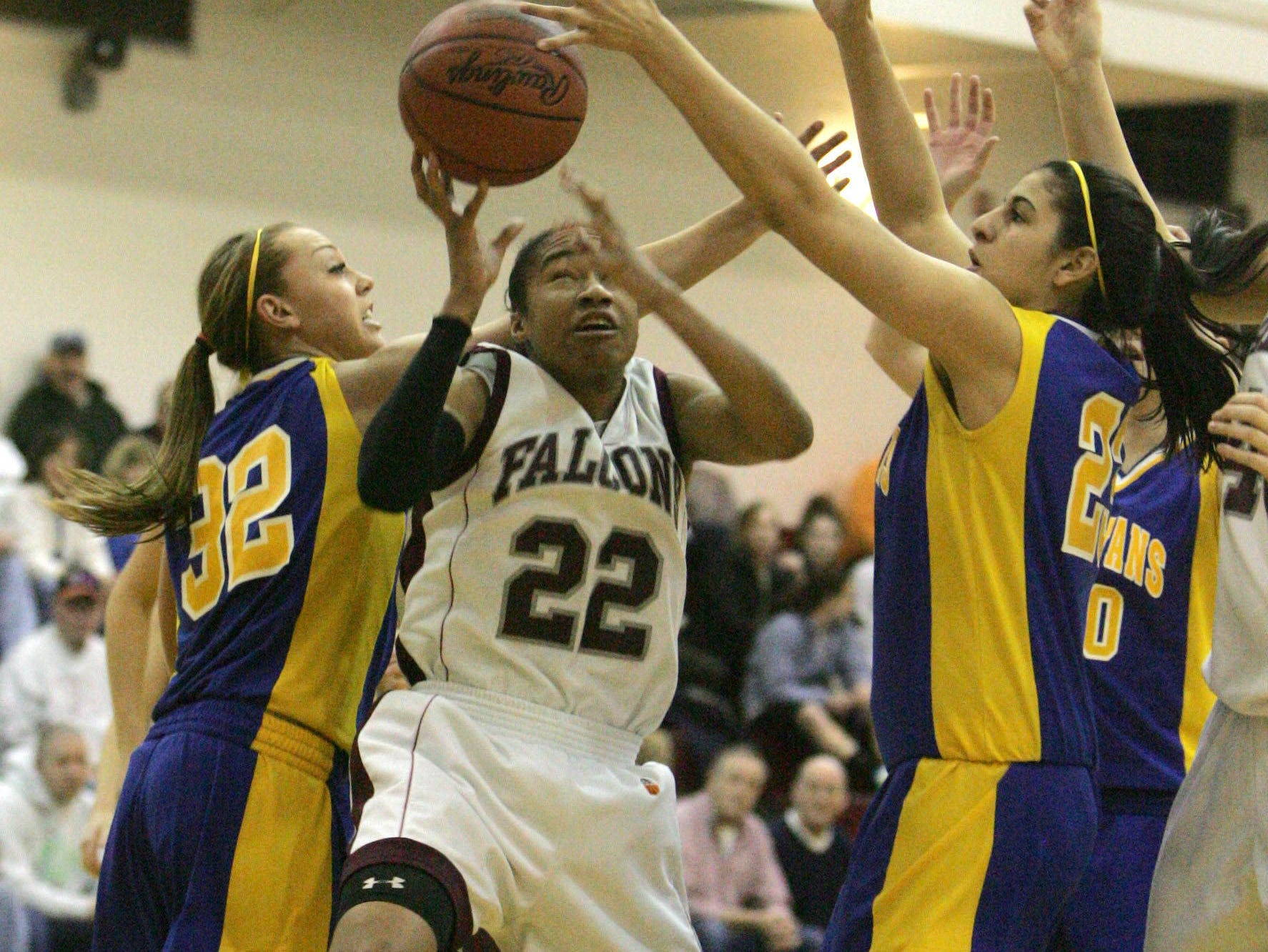 Alaina Walker of Albertus Magnus drives between Megan Jacoby, right, and Erica Spera of Maine-Endwell in the regional girls semi-final game at Vassar College in Poughkeepsie March 11, 2009.  Magnus defeated Maine-Endwell 43-27.