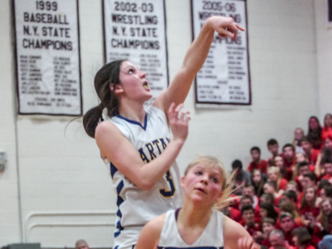 2014: Maine-Endwell's Victoria Dean shoots a 3-pointer behind Wallkill's Bridget McKeever during the opening round of the Class A state tournament. Dean scored 16 points in M-E's victory.