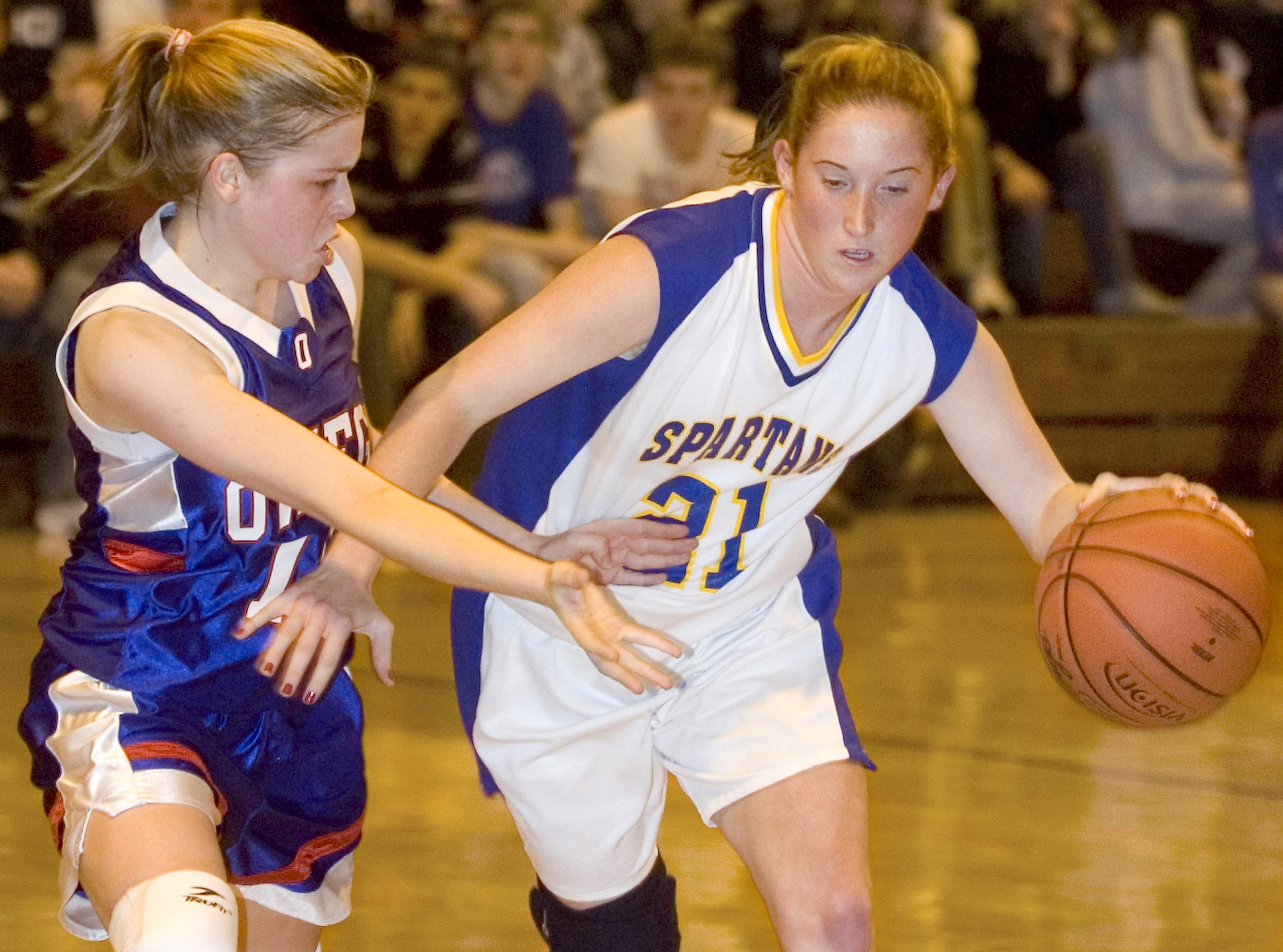 2005: Maine-Endwell High School's Katlin Bushnell, right, works past Owego Free Academy's Alanna Cerretani in the first half of the Wednesday game at Maine-Endwell High School.