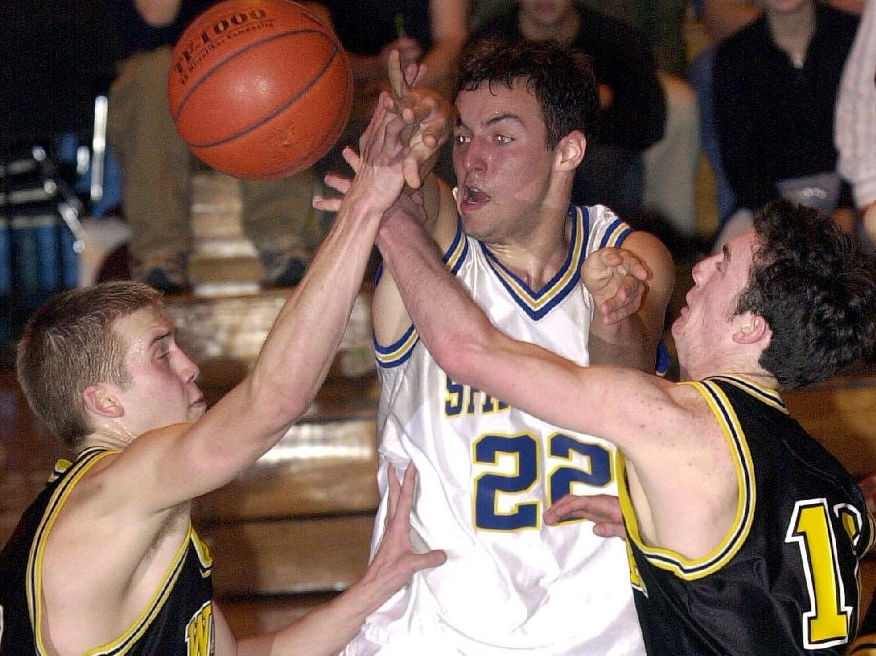 2001: Windsor's Guy Rathmell, left, and Joe Costello, right, try to block a pass from Maine-Endwell's Tyler Springer, center, during the final minutes of Sat's Spartan loss.
