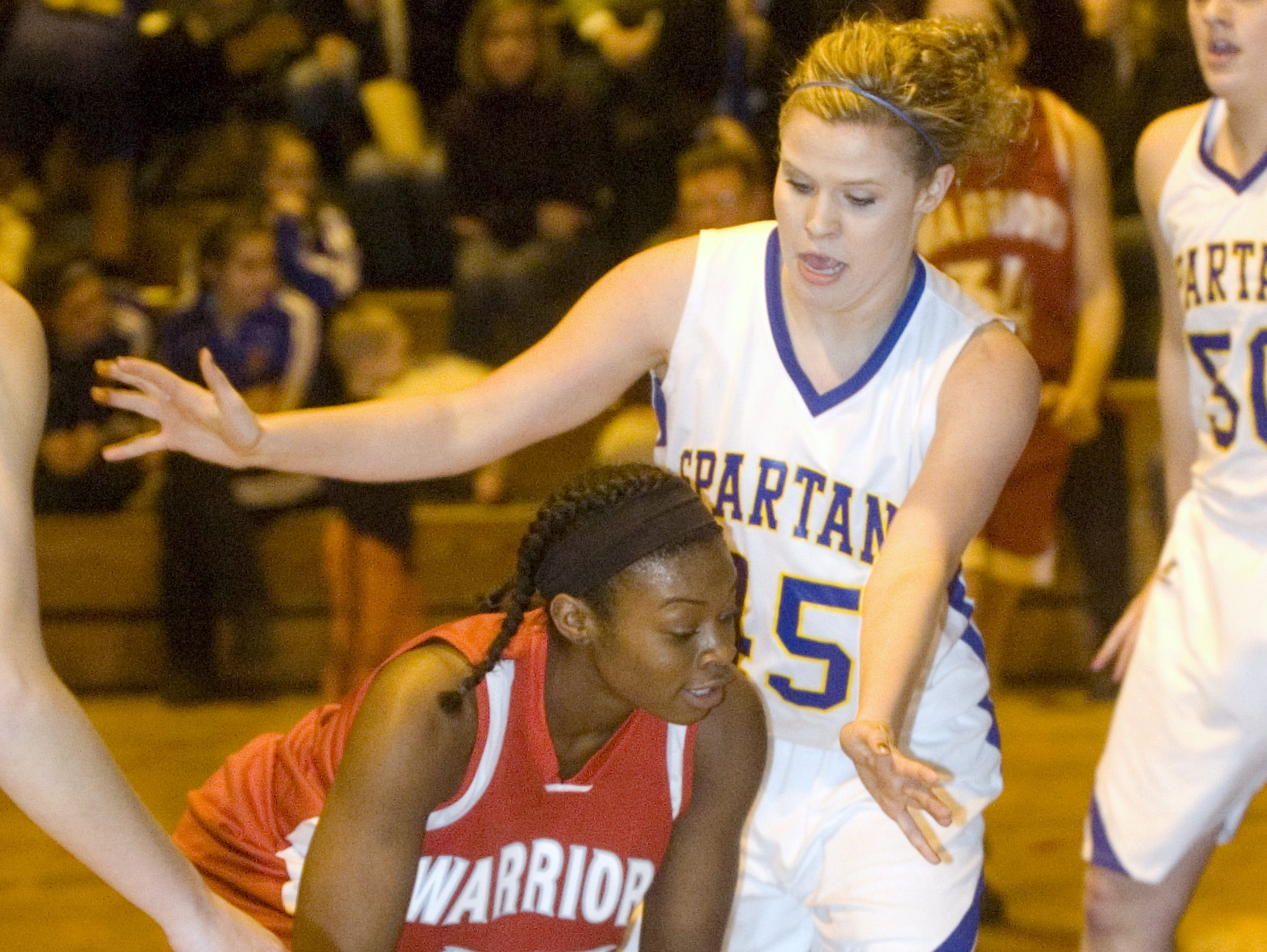 2010: Chenango Valley's Khaylah Moss, left, is guarded by Maine-Endwell's Kristen Chelak in the first quarter of Tuesday's game at M-E.