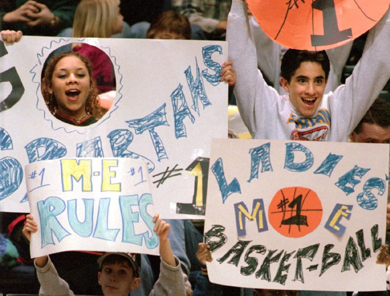 1998: Maine-Endwell basketball fans Laurel Koster, 15, left, and Adam Foldes, 15, cheer their team on during the first half of the Class B Sectional Championship game Friday evening at the Broome County Veterans Memorial Arena.