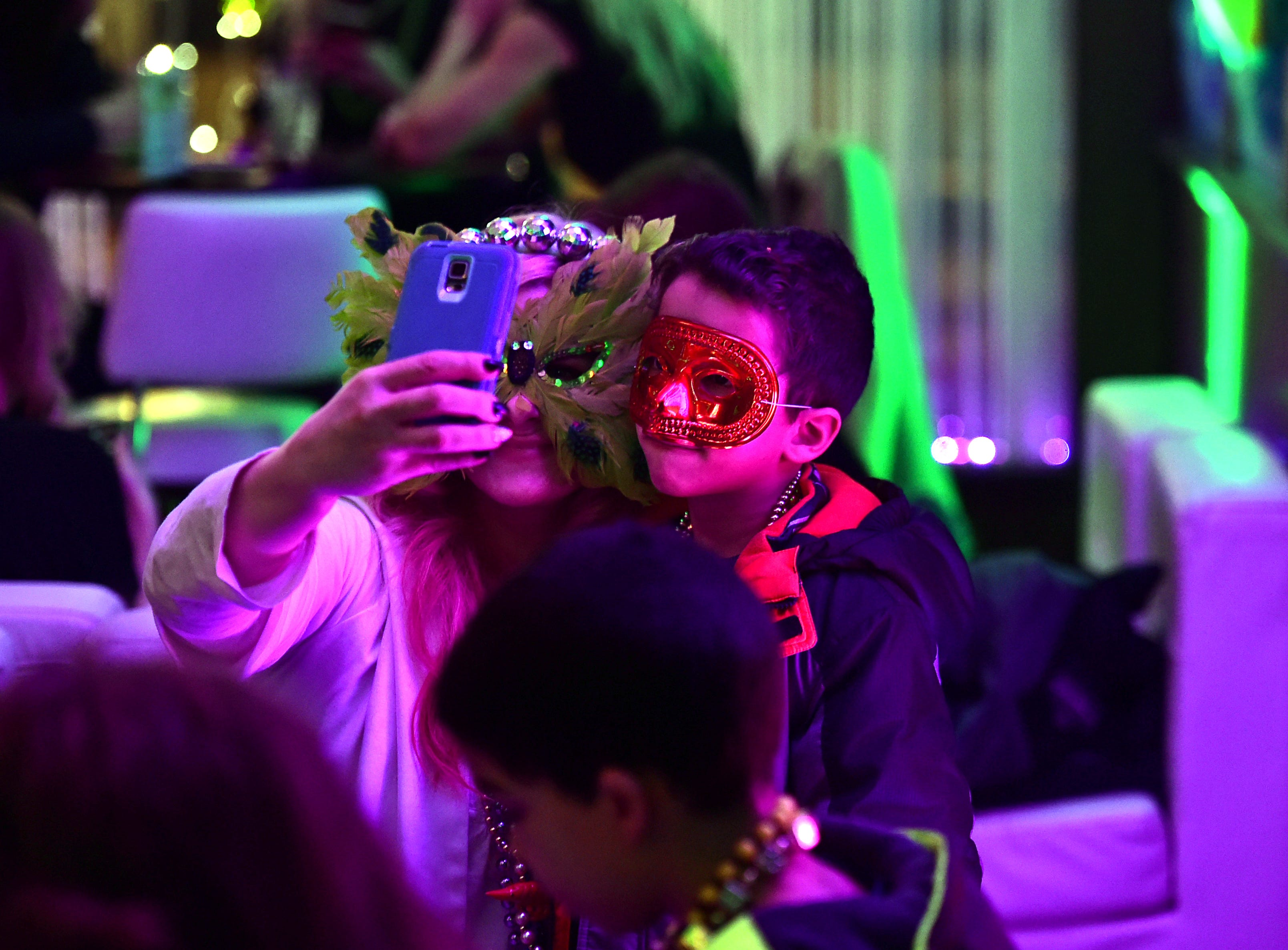People wore masks to celebrate Fat Tuesday during 25th annual Rockin' Mardi Gras Celebration at the Lost Dog Cafe & Lounge in downtown Binghamton. March 5, 2019.