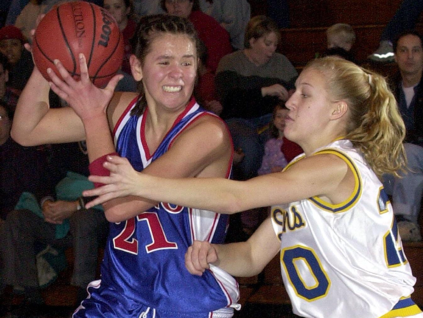 2001: Owego Free Academy's Kyle Dougherty, left, drives down the center of the key as she is guarded by Maine-Endwell's Brittany Pierce, during the second quarter of Sat afternoon's game.