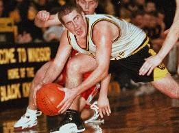 1998: Windsors' Alex Colwell tries to maintain control of the ball during last night Section 4 tournament game against Waverly at Winsdor high school.