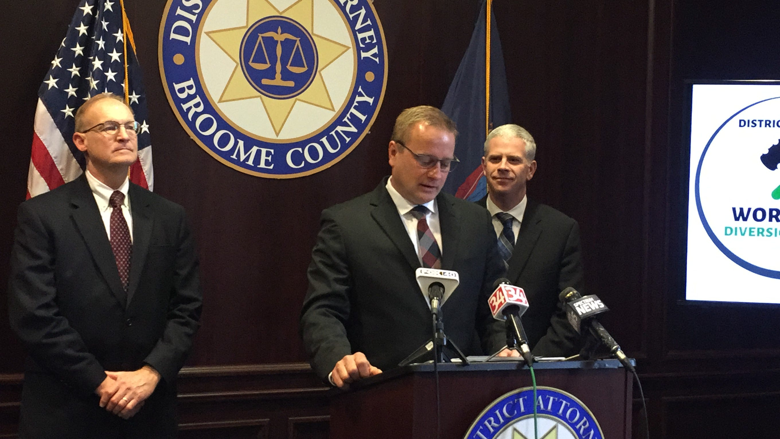 Broome County District Attorney Steve Cornwell, center, and Broome County Executive Jason Garnar, right, announce a workforce diversion program aimed at reducing low-level crimes.