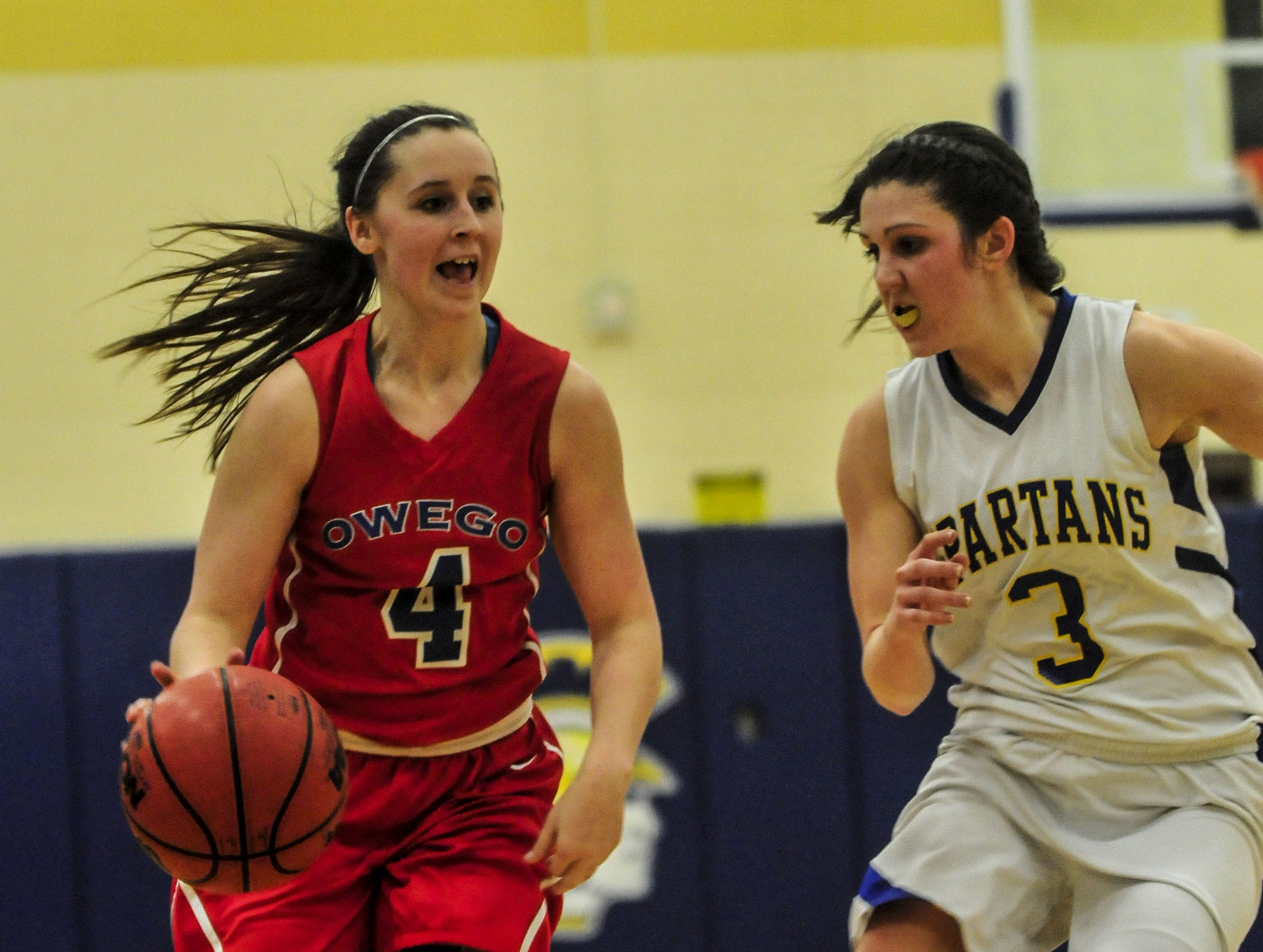 2014: Owego's Kaylee Miner tries to get past Maine-Endwell's Victoria Dean during the STAC semifinal on Wednesday. Visiting Owego advanced to the STAC final with a 62-60 victory.