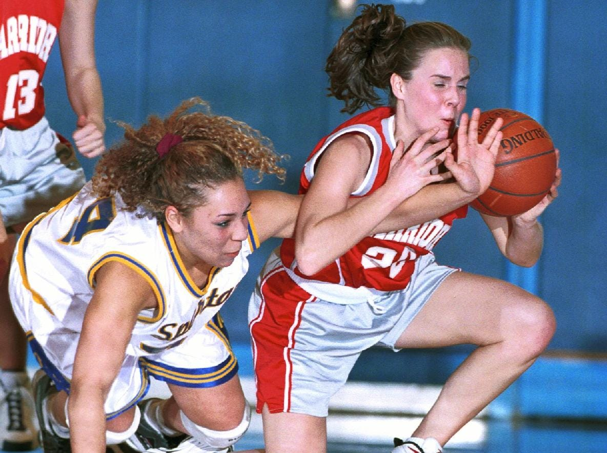 1998: Maine-Endwell's Laurel Koster, left, and Chenango Valley's Courtney Pierce dive to the ground after a loose ball in the first half of play Thursday evening at Maine-Endwell High School.