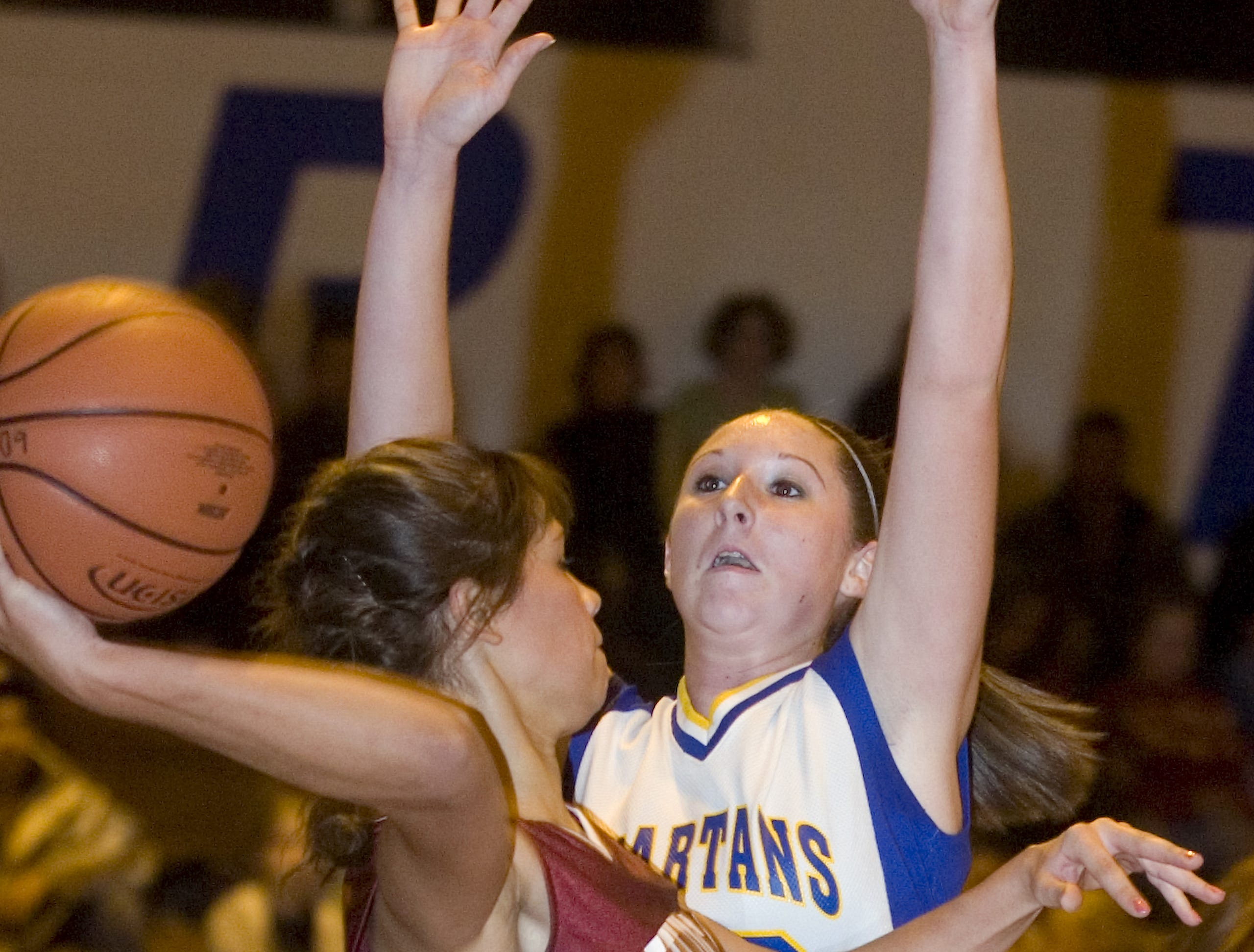 2008: Johnson City's Krystal Newborn, left, gets pressure from Maine-Endwell's Carrie Bushnell in the first quarter of Friday's game at M-E.