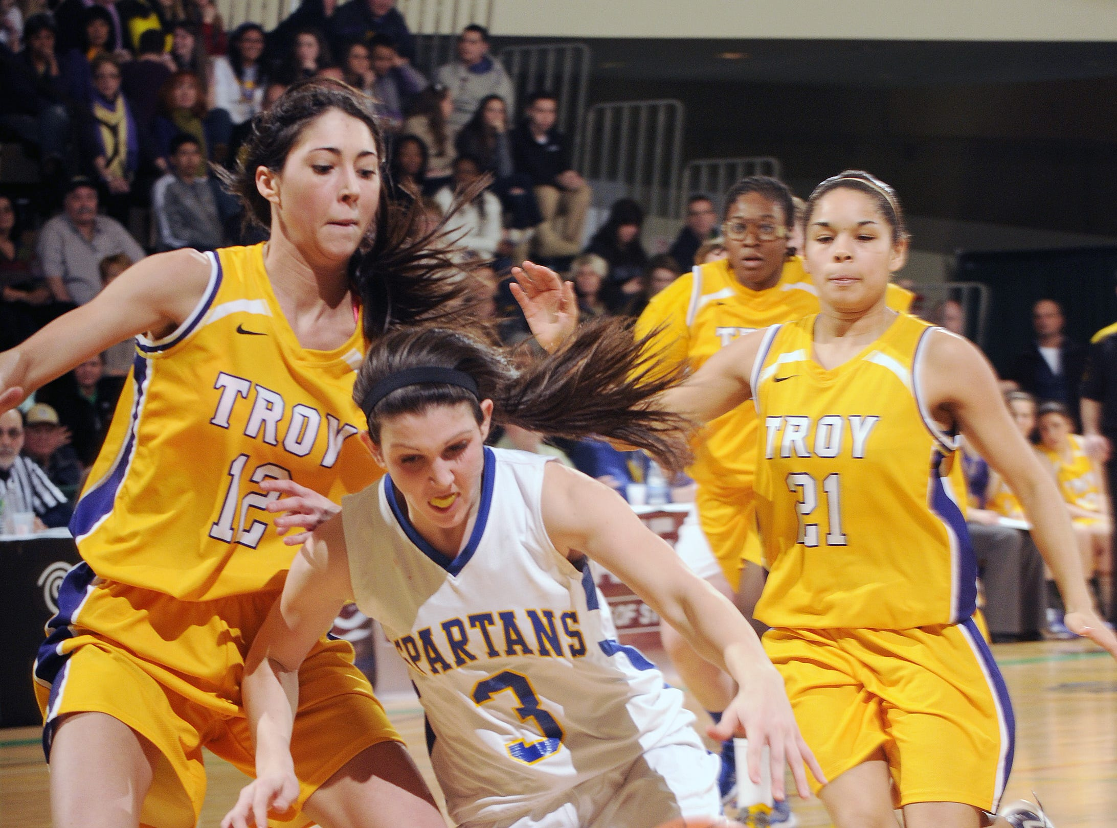2013: Maine-Endwell's Victoria Dean, 3, drives to the rim Saturday in the state Class A girls basketball final in Troy. The Spartans lost to Troy, 46-30.