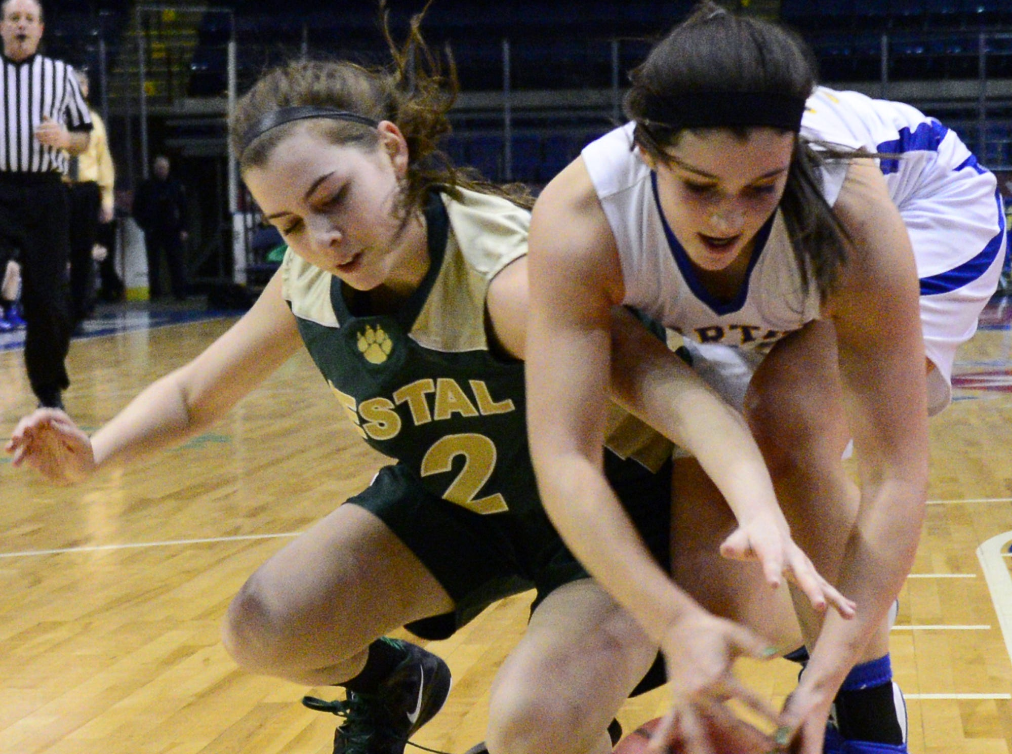 2013: Maine-Endwell's Daniella Dean and Vestal's Molly Liss battle for possession during Friday's Section 4 Class A championship game at the Broome County Veterans Memorial Arena.
