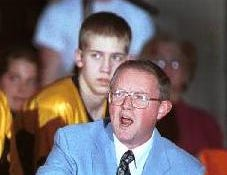 2001: Windsor boys basketball coach Gary Vail directs the action from the floor in front of his bench during a recent game.