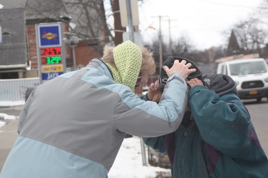Reverand Gail Wolling, the Interim Pastor at Christ the King Lutheran Church in Vestal, distributes ashes on Main Street in Binghamton for Ash Wednesday.