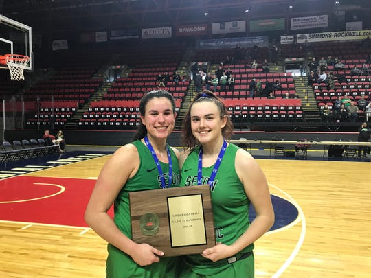 Seton Catholic Central's Marina Maerkl, left, and Julia Hauer, seen here holding the Section 4 Class A championship plaque after defeating Maine-Endwell, 60-45 Saturday, have formed a special relationship on and off the court during their seasons as teammates.