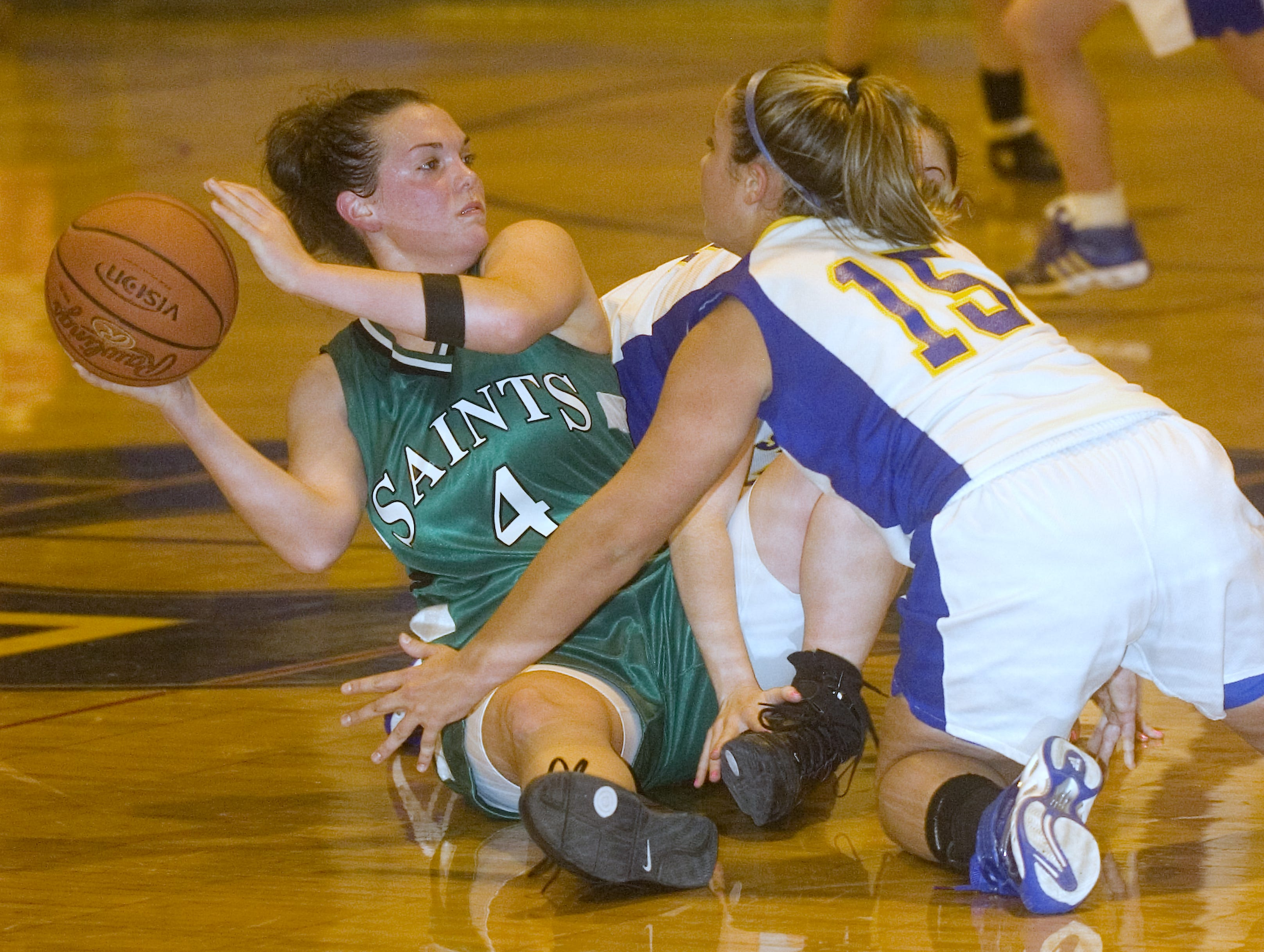 2009: Seton Catholic Central's Katherine Torto, left, looks to pass after collecting the loose ball as Maine-Endwell's Kaitlyn Harris defends in the second quarter of Friday's game at M-E.