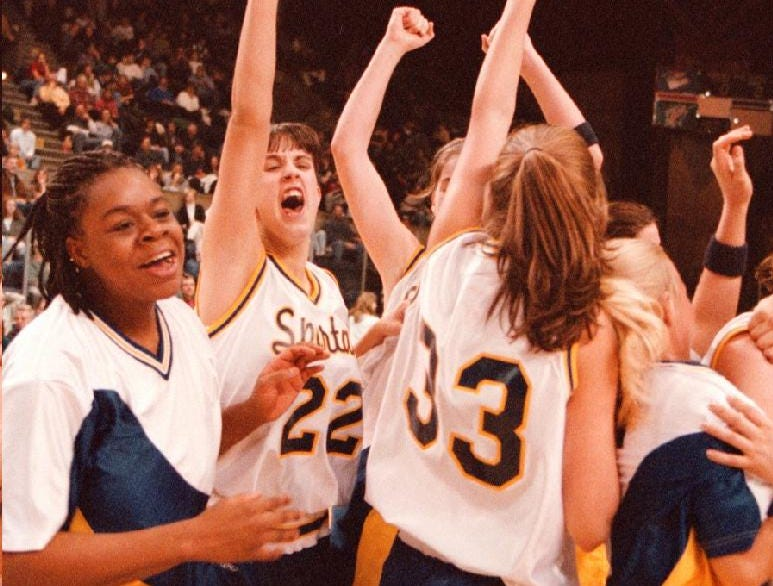 1998: The Maine-Endwell girls basketball team celebrate their 59 to 50 over Norwich and winning a STAC Championship.