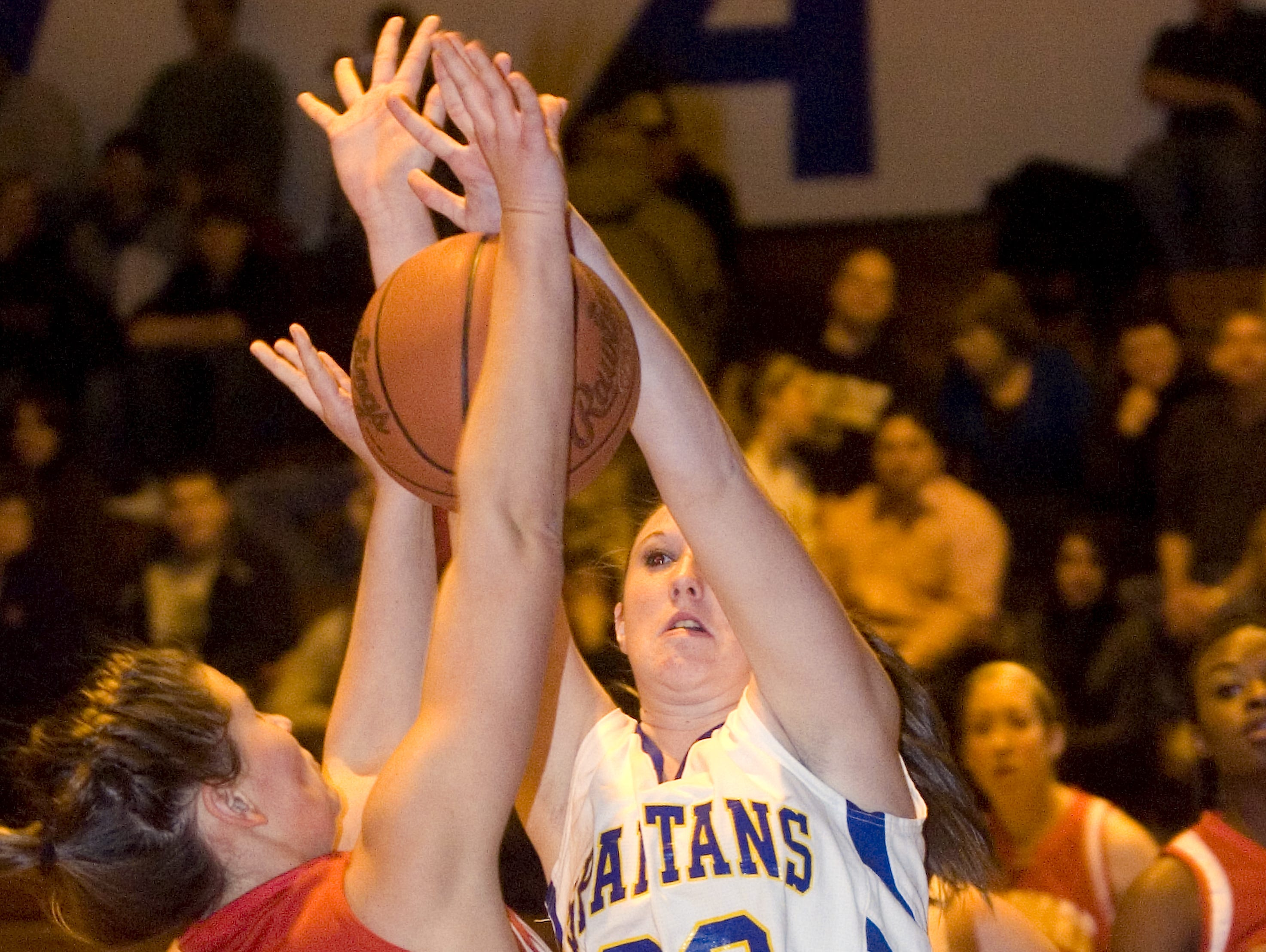 2010: Chenango Valley's Mikala King, left, is blocked by Maine-Endwell's Carrie Bushnell in the first quarter of Tuesday's game at M-E.