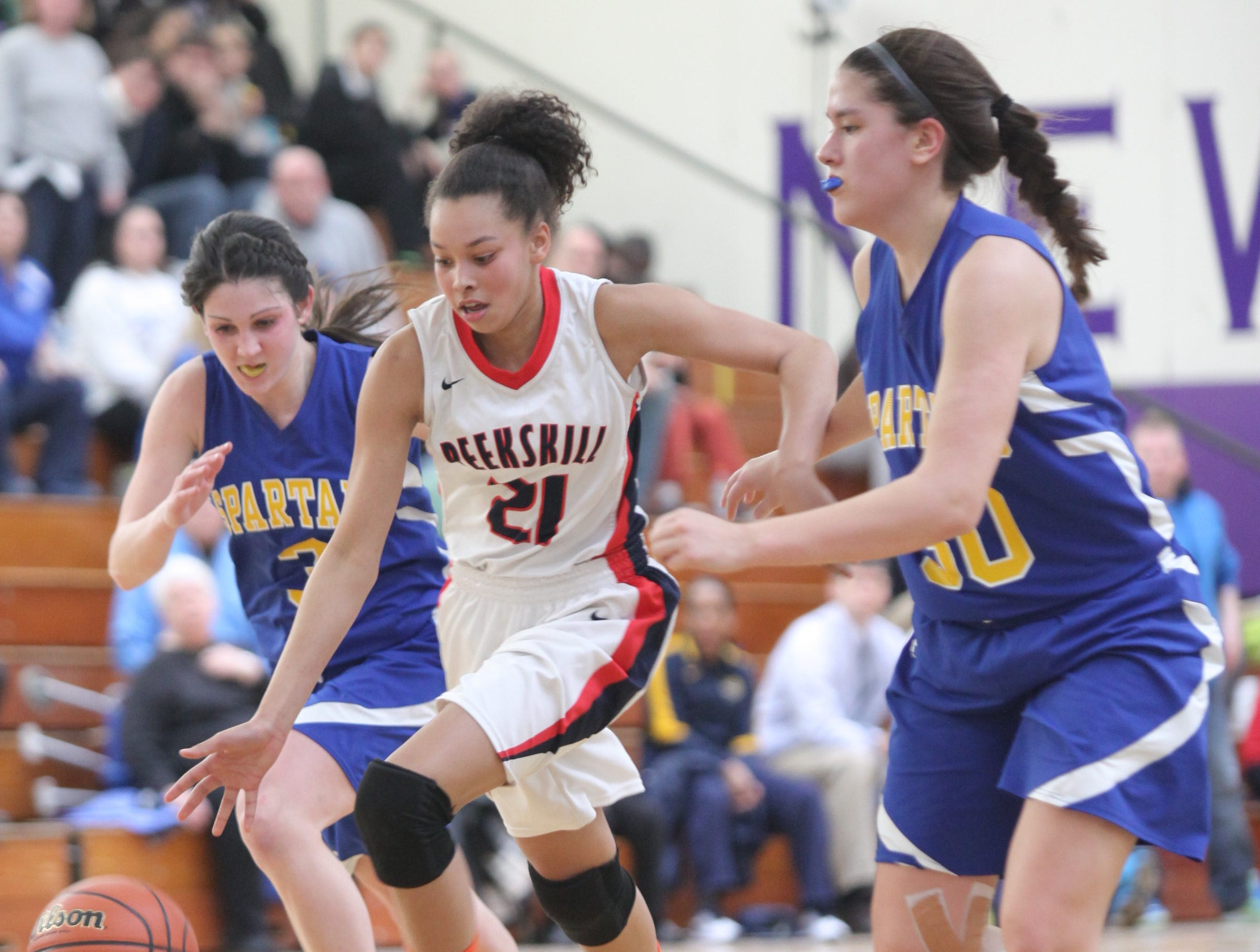 2014: Maine-Endwell's defense focuses on Peeksill's Lisana Burnett during Saturday's Class A state quarterfinal girls basketball game at New Rochelle High School. Maine-Endwell defeated Peekskill 62-47.