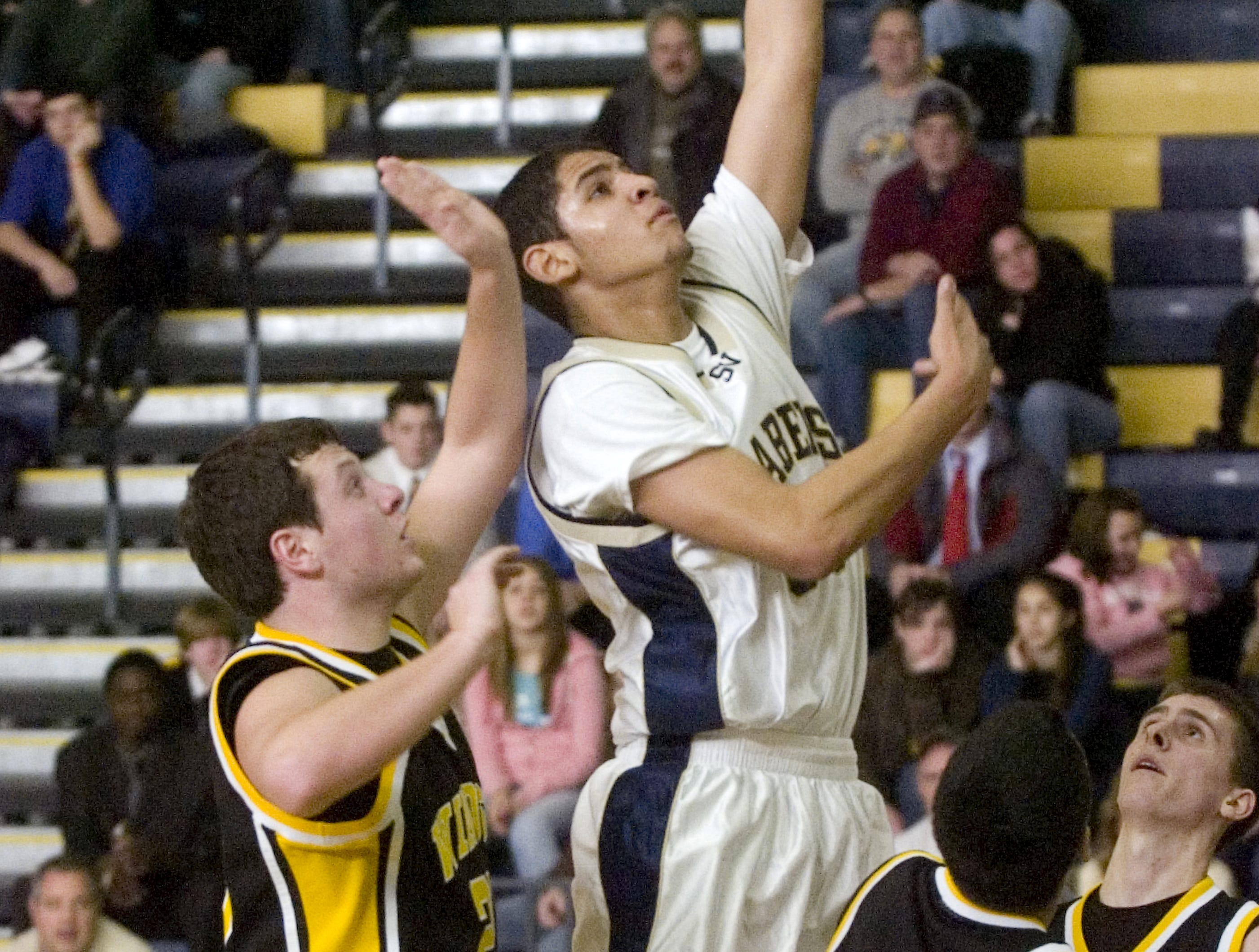 2009: Susquehanna Valley's Matt Cornwell slips by Windsor's Paul Gordon, left, for a lay up in the first quarter of Saturday's game at SV.