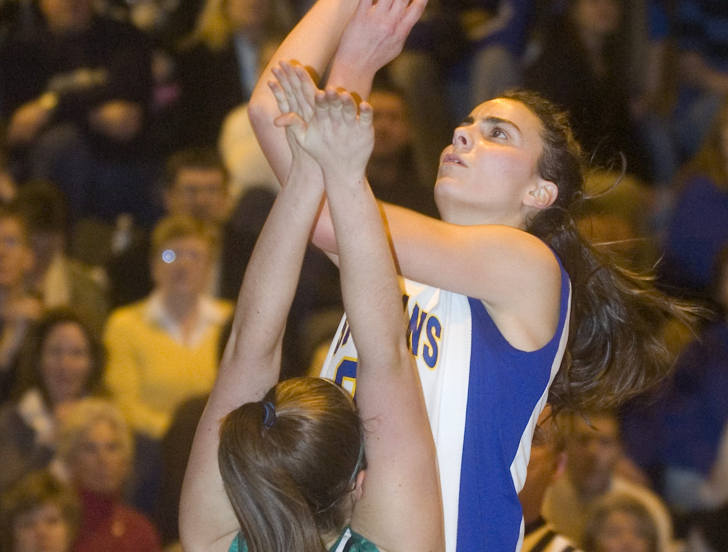 2009: Maine-Endwell's Megan Touhey, left, shoots over Seton Catholic Central's Miranda Desanctis in the second quarter of Friday's game at M-E.