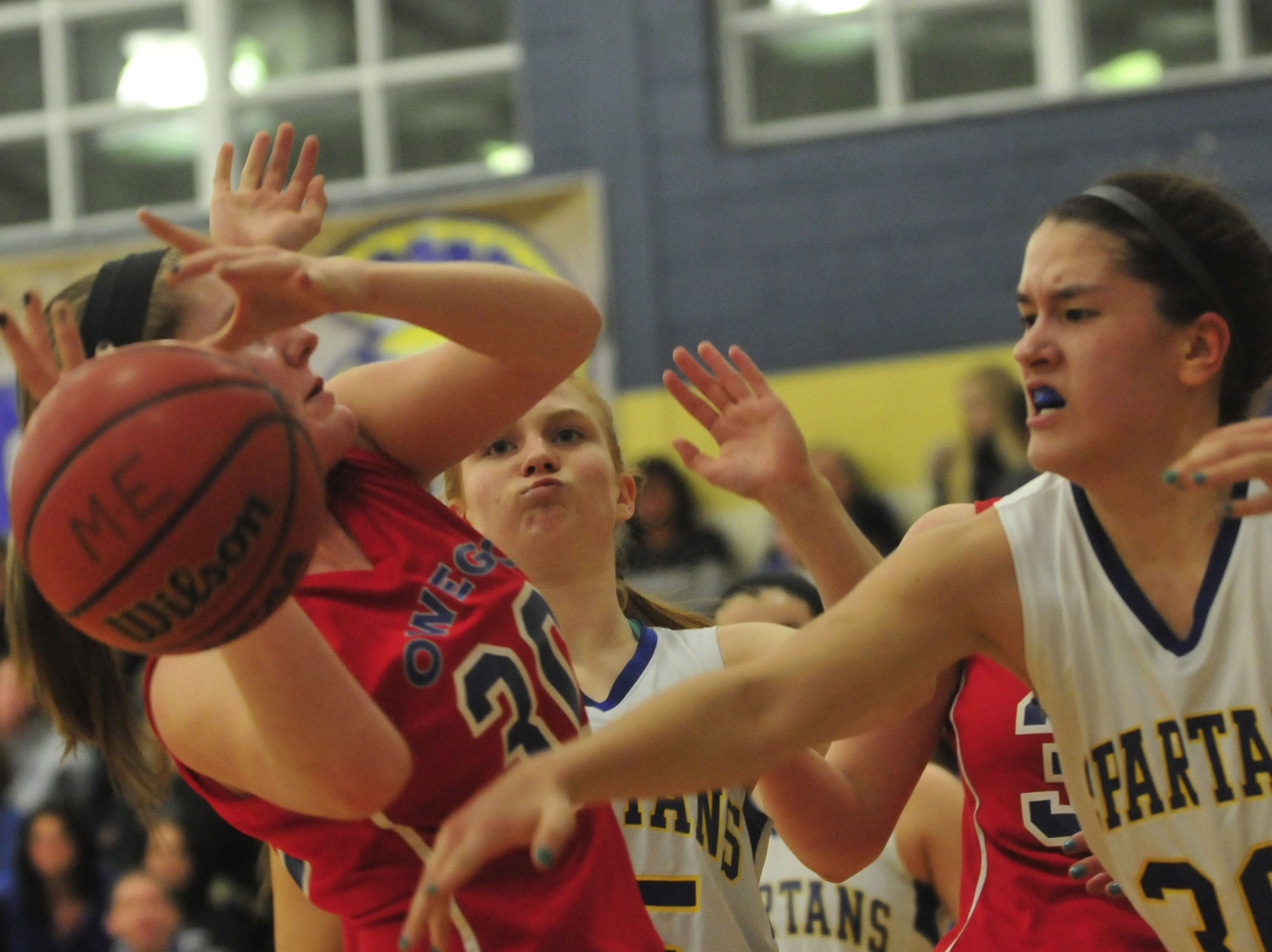 2014: Maine-Endwell's Julie Yacovoni smacks the ball out of the hands of Owego's Emily Merrill during the STAC semifinal on Wednesday. Yacovoni scored 13 points.