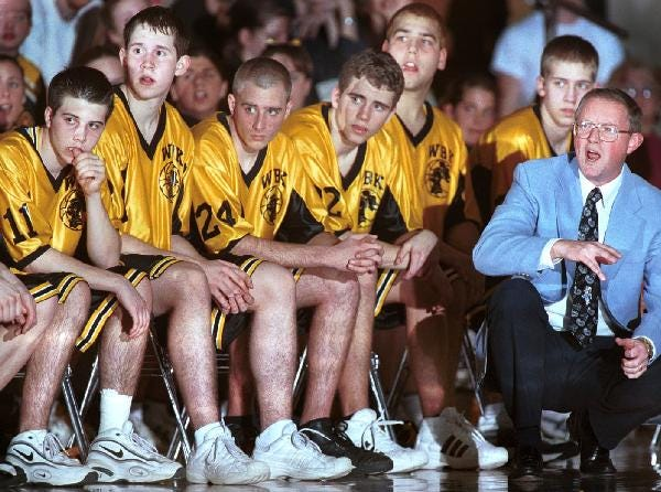1998: Windsor boys basketball coach Gary Vail directs the action from the floor in front of his bench during a recent game.