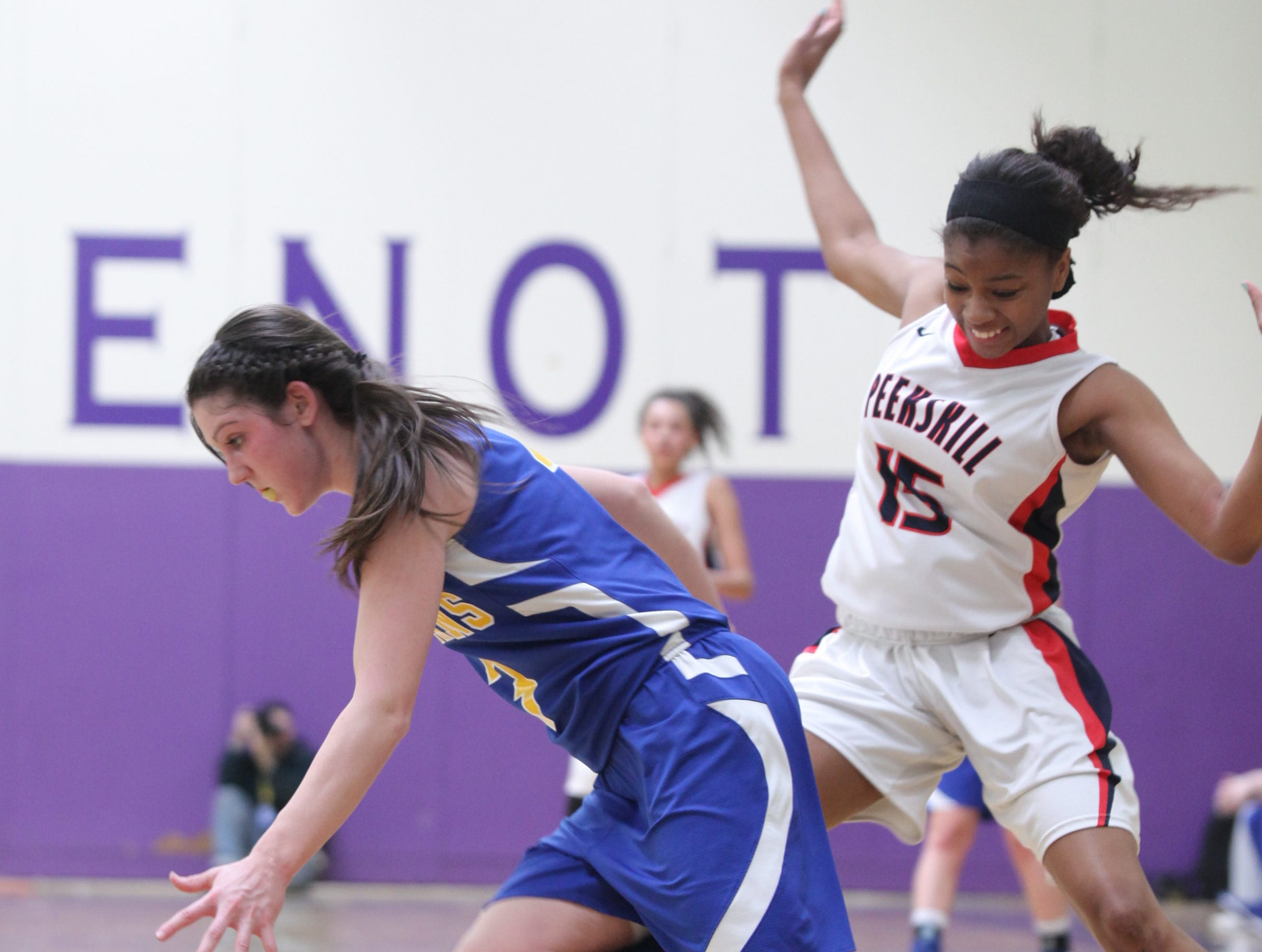 2014: Maine-Endwell's Victoria Dean dribbles past Peekskill's Adriane Jackson in the Class A state quarterfinal Saturday at New Rochelle High School. Dean scored 12 points in the Spartans' 62-47 victory.