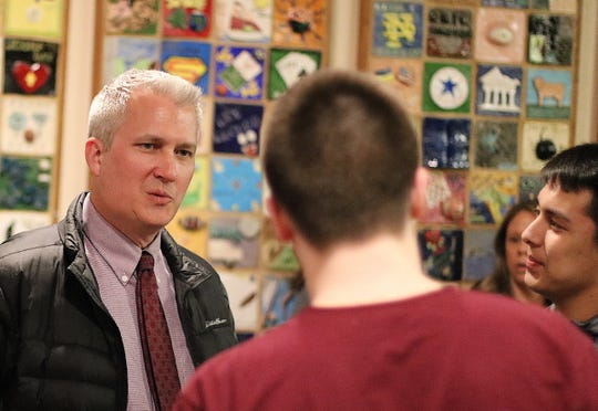 South Kitsap football coach Dan Ericson talks to students during a meet-and-greet at the high school Tuesday.