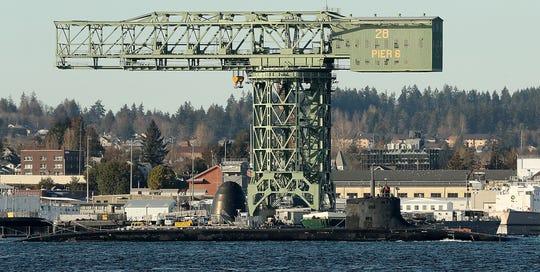 A naval submarine departs Naval Base Kitsap Bremerton on Tuesday, March 5, 2019.
