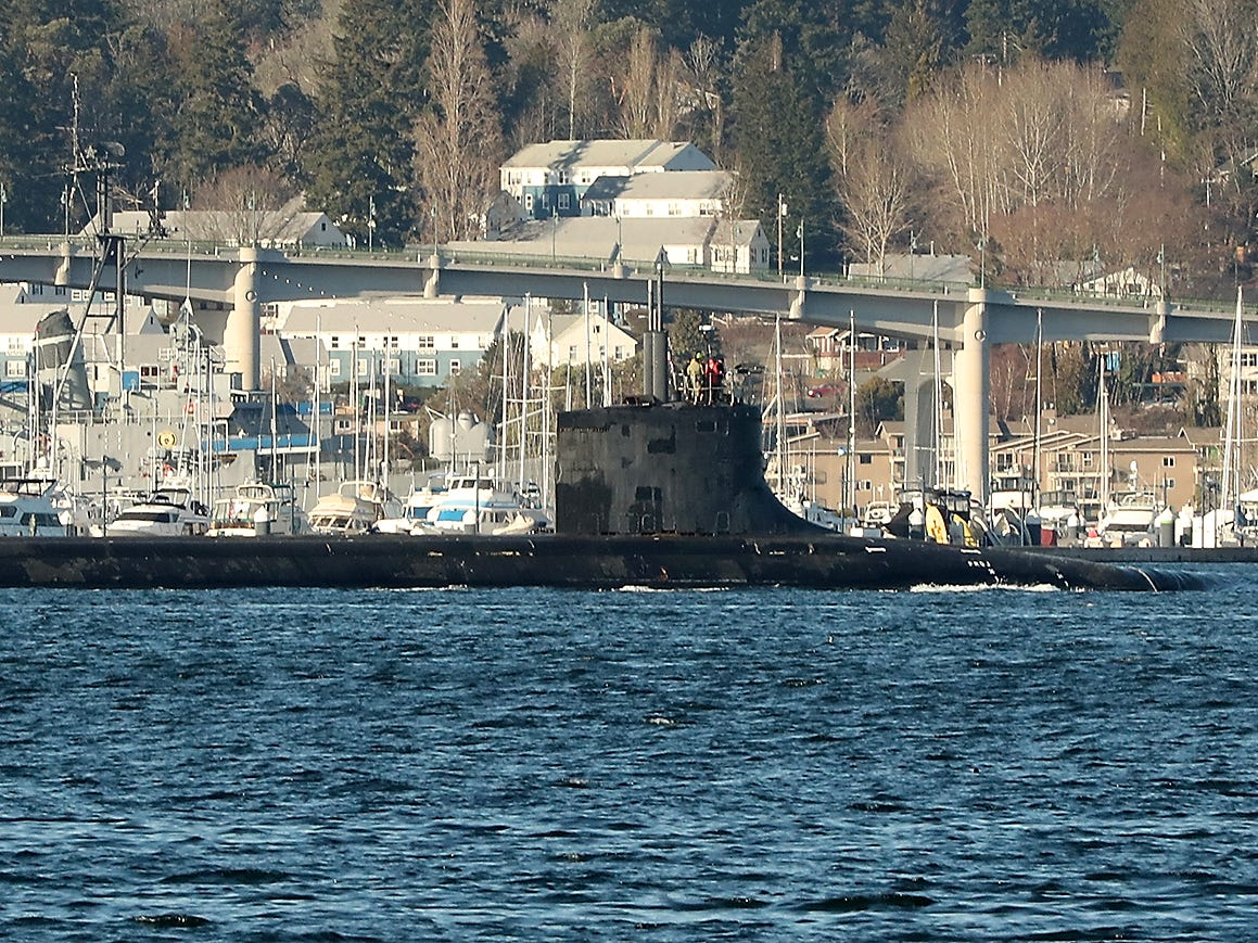 A naval submarine departs Naval Base Kitsap Bremerton on Tuesday, March 5, 2019.