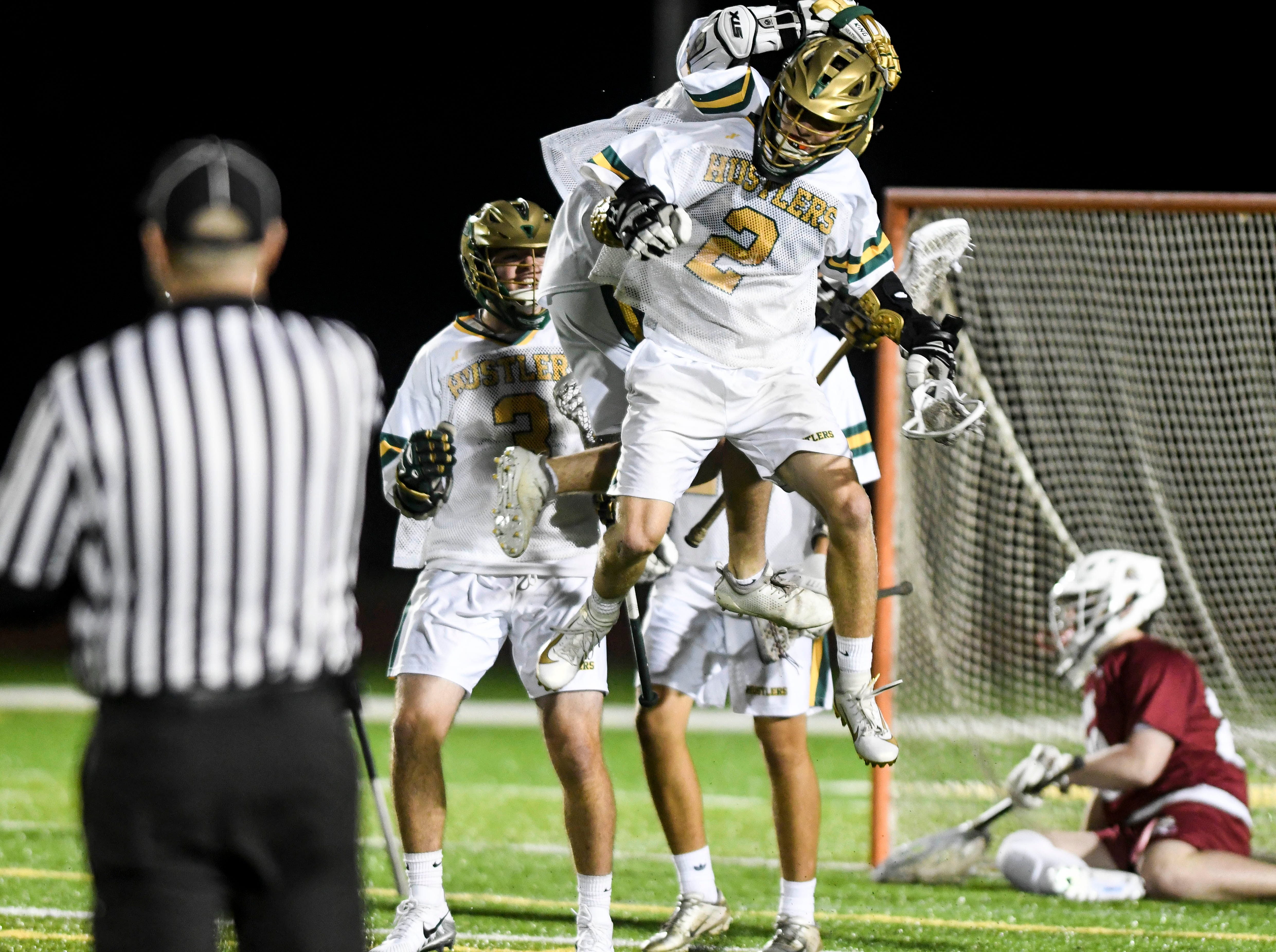 Jeremy Goslant of Melbourne Central Catholic (2) celebrates a goal with teammates during Tuesday's game in Melbourne.